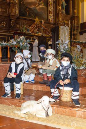 Galería fotográfica del belén viviente y misa de vigilia de Navidad 38